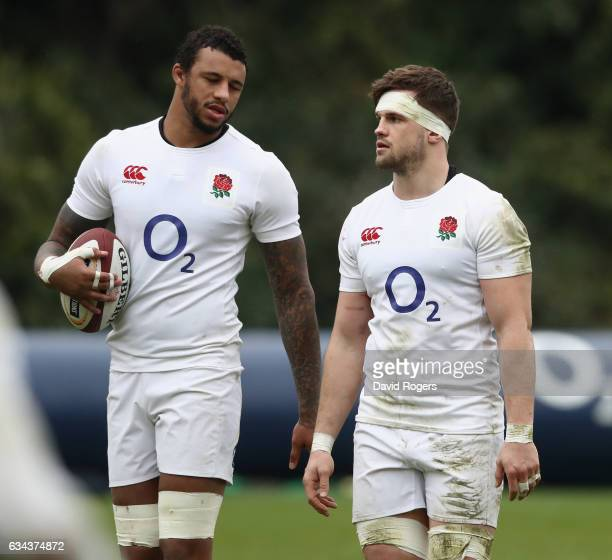 Jack Clifford talks to team mate Courtney Lawes during the England training session held at Pennyhill Park on February 9 2017 in Bagshot England