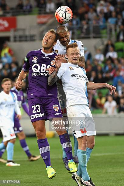 Jack Clisby of Melbourne City Patrick Kisnorbo of Melbourne City and Krisztian Vadocz of Perth Glory contest for a header during the ALeague...
