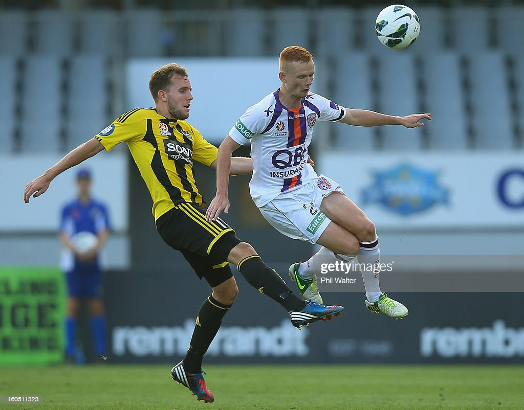 Jack Clisby of Perth (R) and Jeremy Brockie of Wellington compete for the ball during the round 19 A-League match between the Wellington Phoenix and the Perth Glory at Eden Park on February 2, 2013 in Auckland, New Zealand.