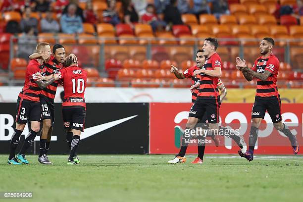 Jack Clisby of the Wanderers celebrates with his team mates after setting up a goal for Jumpei Kusukami of the Wanderers during the round eight...