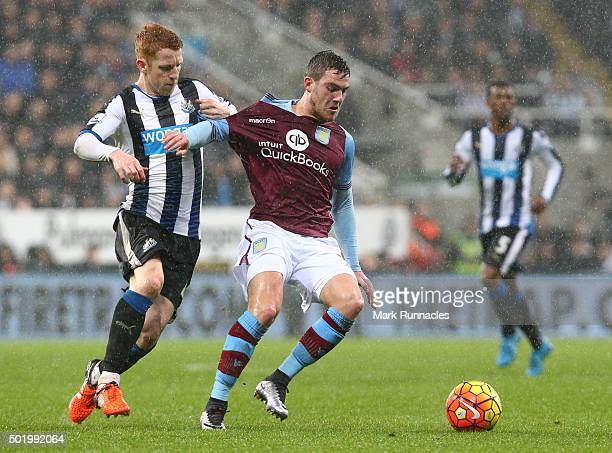 Jack Colback of Newcastle is tackled by Jordan Veretout of Aston Villa during the Barclays Premier League match between Newcastle United FC and Aston...