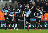 Jack Colback of Newcastle United celebrates with team mates as he scores their first goal during the Barclays Premier League match between Newcastle...