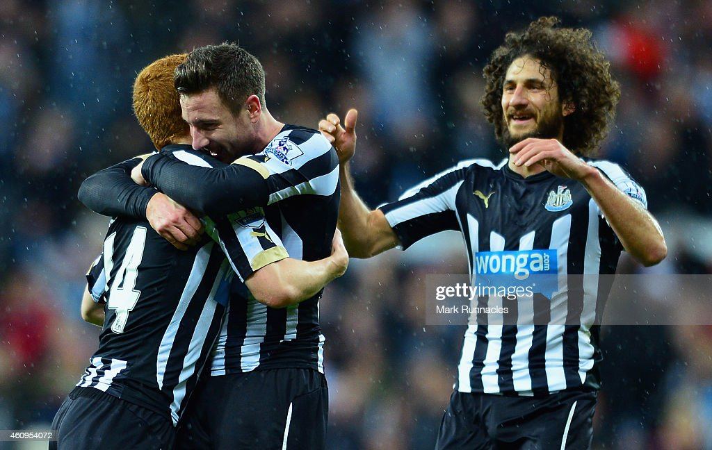 Jack Colback of Newcastle United (L) is congratulated on scoring their second goal by Paul Dummett (C) and Fabricio Coloccini of Newcastle United during the Barclays Premier League match between Newcastle United and Burnley at St James' Park on January 1, 2015 in Newcastle upon Tyne, England.