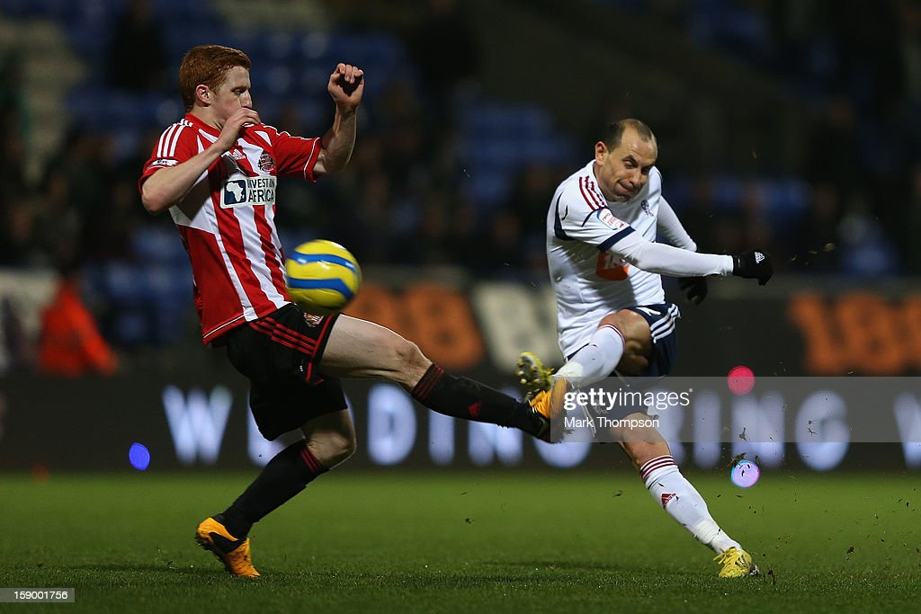<a gi-track='captionPersonalityLinkClicked' href=/galleries/search?phrase=Jack+Colback&family=editorial&specificpeople=4940395 ng-click='$event.stopPropagation()'>Jack Colback</a> of Sunderland attempts to block the shot of <a gi-track='captionPersonalityLinkClicked' href=/galleries/search?phrase=Martin+Petrov&family=editorial&specificpeople=643515 ng-click='$event.stopPropagation()'>Martin Petrov</a> of Bolton Wanderers during the FA Cup with Budweiser Third Round match between Bolton Wanderers and Sunderland at the Reebok Stadium on January 5, 2013 in Bolton, England.
