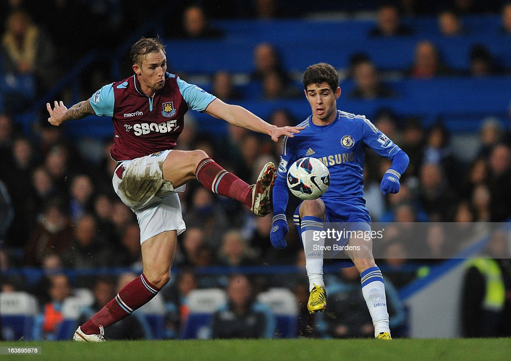 Jack Collinson of West Ham United challenges for the ball with Oscar of Chelsea during the Barclays Premier League match between Chelsea and West Ham United at Stamford Bridge on March 17, 2013 in London, England.