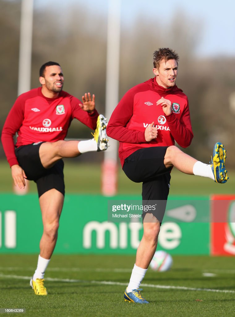 <a gi-track='captionPersonalityLinkClicked' href=/galleries/search?phrase=Jack+Collison&family=editorial&specificpeople=4431214 ng-click='$event.stopPropagation()'>Jack Collison</a> (R) and Hal Robson-Kanu (L) warm up during the Wales training session at Hensol Castle Park on February 4, 2013 in Cardiff, Wales.