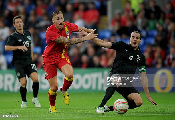 Jack Collison of Wales in action with John O'Shea of Ireland during the International Friendly match between Wales and Ireland at Cardiff City...