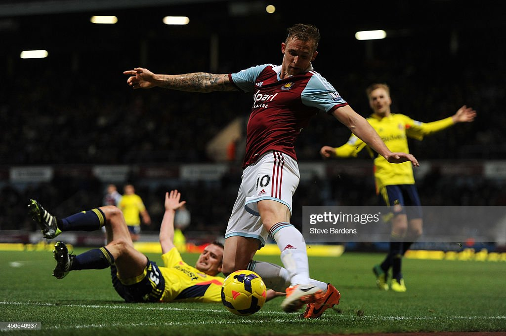 Jack Collison of West Ham attempts to keep the ball in play during the Barclays Premier League match between West Ham United and Sunderland at Boleyn...