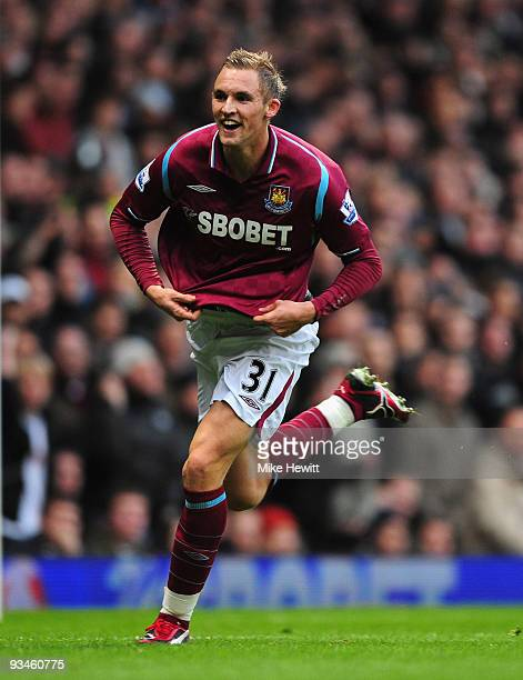Jack Collison of West Ham celebrates after scoring the first goal during the Barclays Premier League match between West Ham United and Burnley at...
