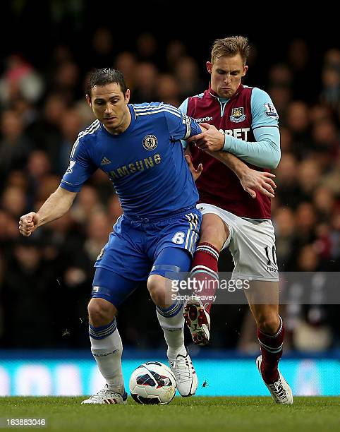 Jack Collison of West Ham challenges Frank Lampard of Chelsea during the Barclays Premier League match between Chelsea and West Ham United at...