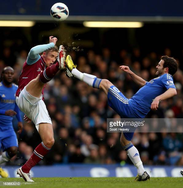 Jack Collison of West Ham in action with Juan Mata of Chelsea during the Barclays Premier League match between Chelsea and West Ham United at...