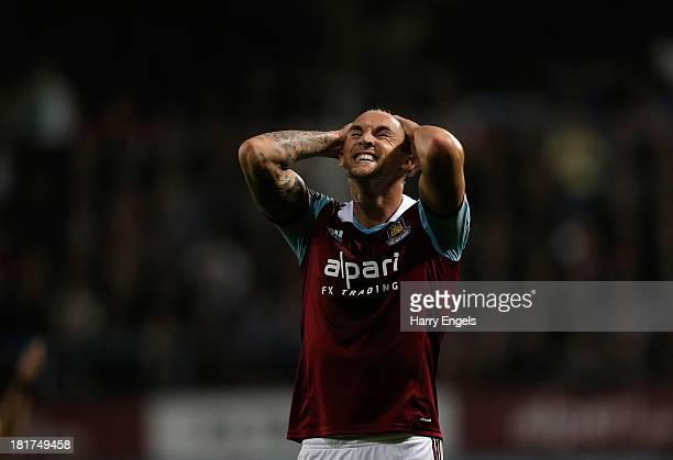 Jack Collison of West Ham reacts during the Capital One Cup third round match between West Ham United and Cardiff City at the Boleyn Ground on...