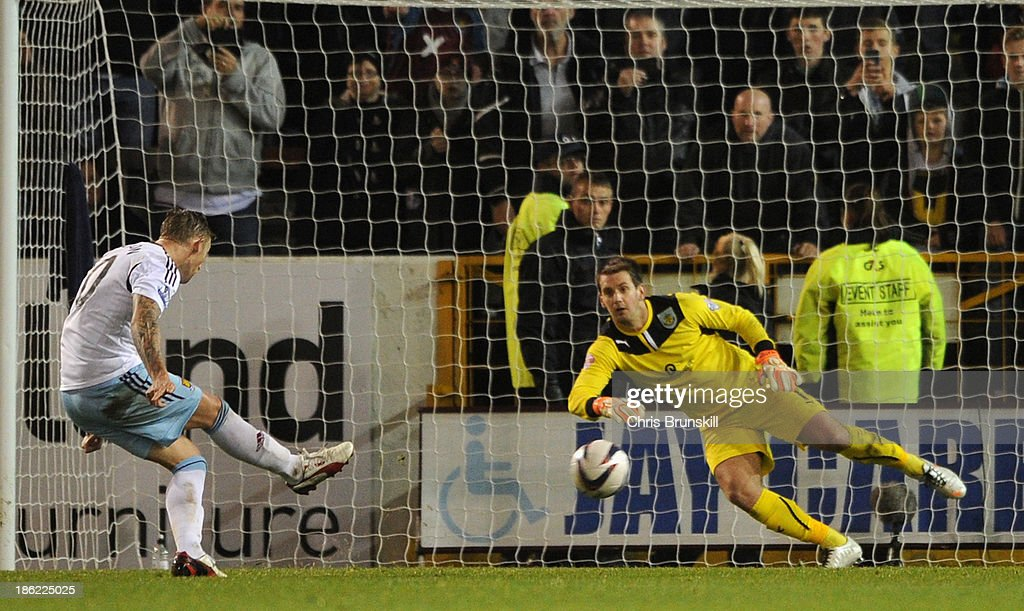 Jack Collison of West Ham scores the second goal from the penalty spot during the Capital One Cup Fourth Round match between Burnley and West Ham...