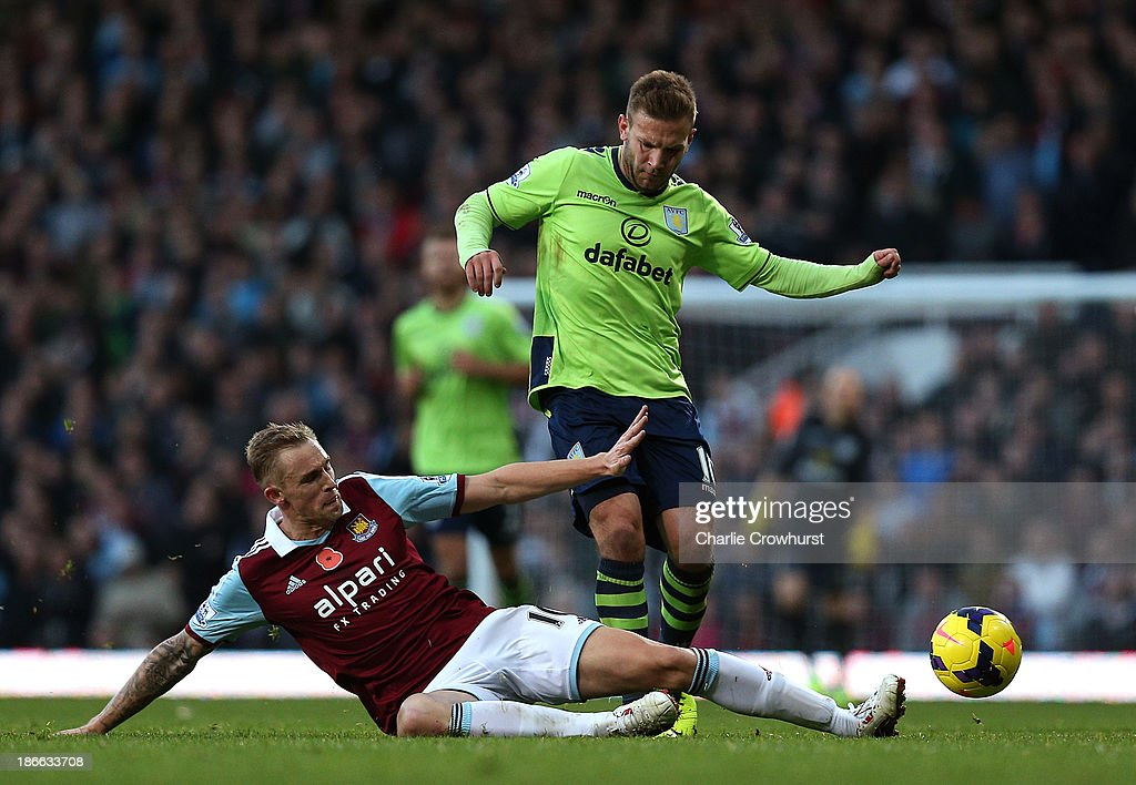 Jack Collison of West Ham tackles Andreas Weimann of Villa during the Barclays Premier League match between West Ham United and Aston Villa at Upton...