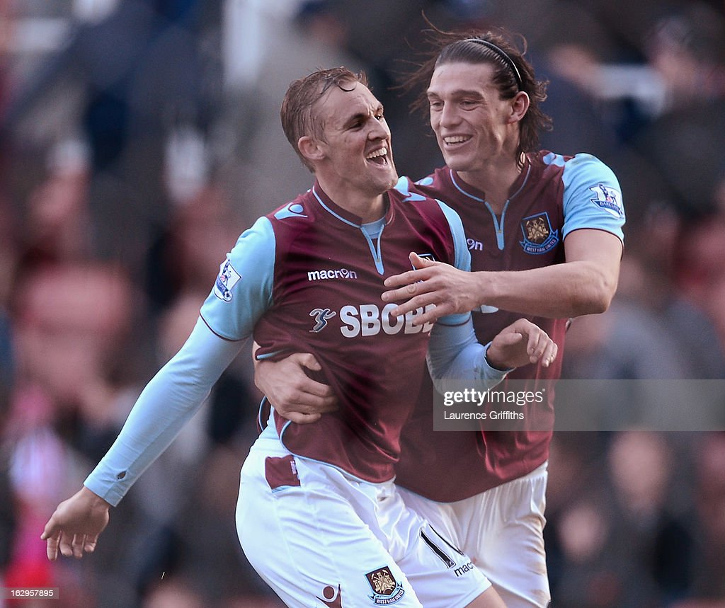 Jack Collison of West Ham United celebrates his goal with Andy Carroll during the Barclays Premier League match between Stoke City and West Ham...