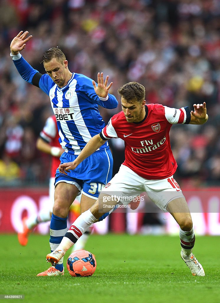 Jack Collison of Wigan Athletic and Aaron Ramsey of Arsenal battle for the ball during the FA Cup SemiFinal match between Wigan Athletic and Arsenal...