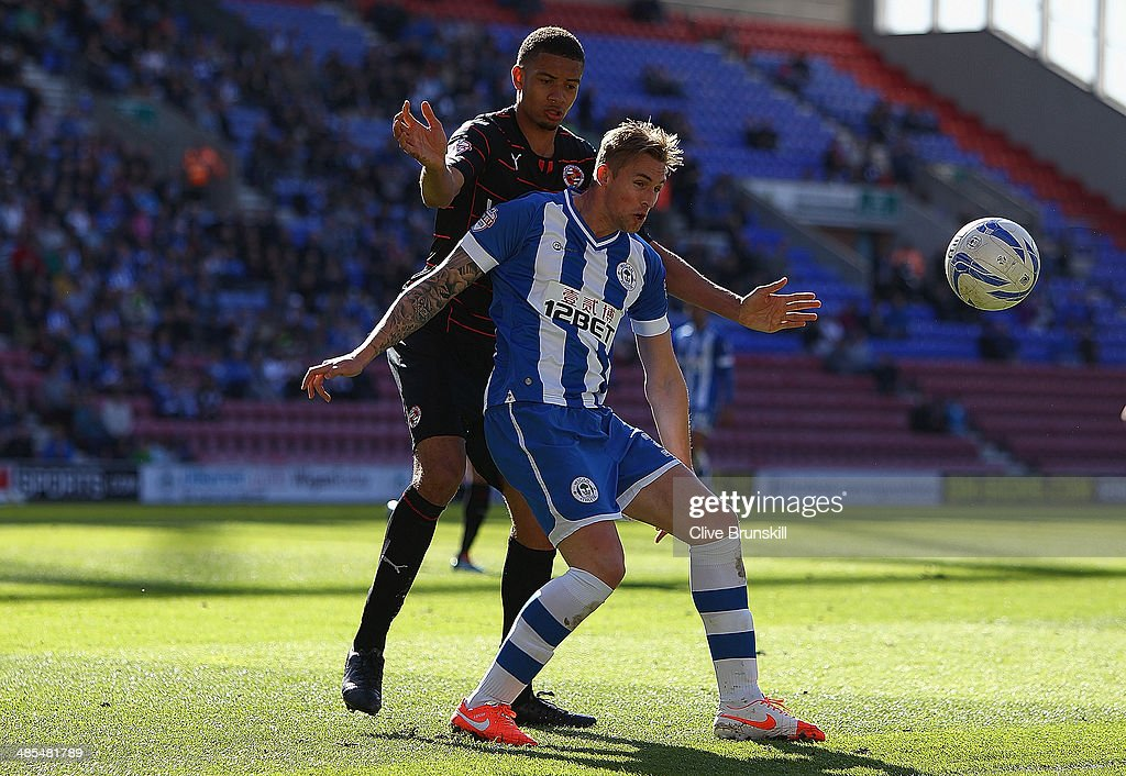 Jack Collison of Wigan Athletic in action with Michael Hector of Reading during the Sky Bet Championship match between Wigan Athletic and Reading at...