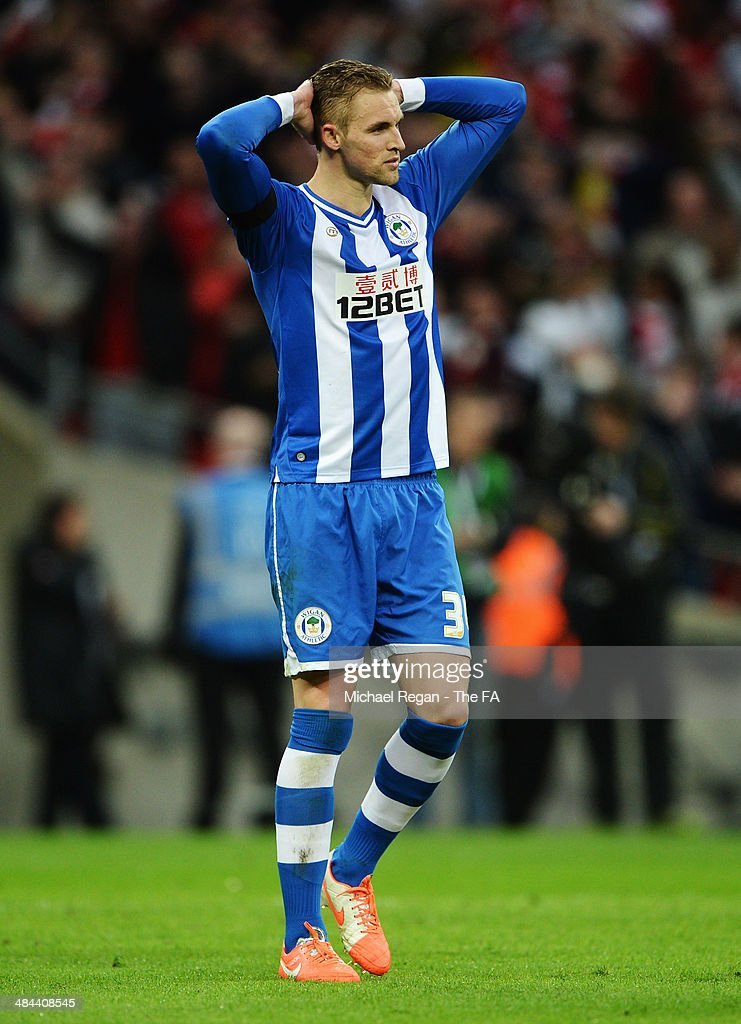 Jack Collison of Wigan Athletic reacts after having his penalty saved in a penalty shootout during the FA Cup SemiFinal match between Wigan Athletic...