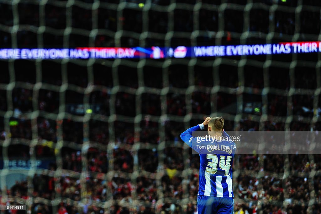 Jack Collison of Wigan Athletic reacts after missing a penalty in the penalty shootout during the FA Cup SemiFinal match between Wigan Athletic and...