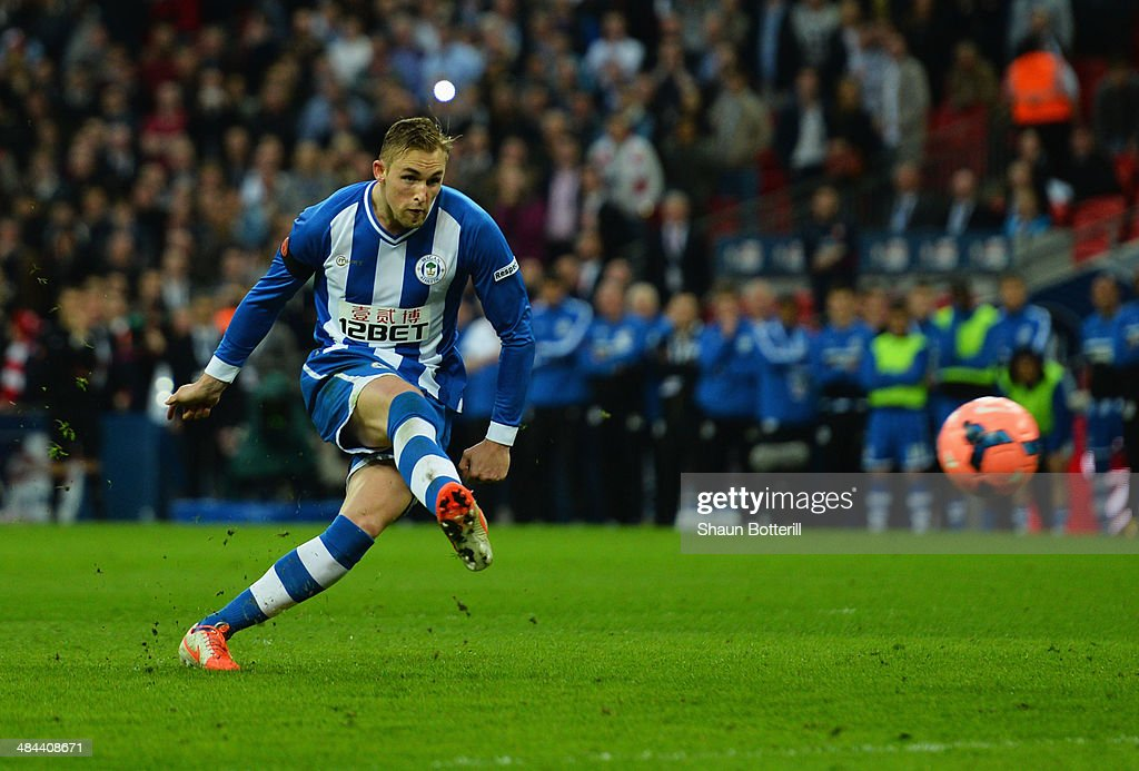 Jack Collison of Wigan Athletic shoots and misses in the penalty shoot out during the FA Cup SemiFinal match between Wigan Athletic and Arsenal at...