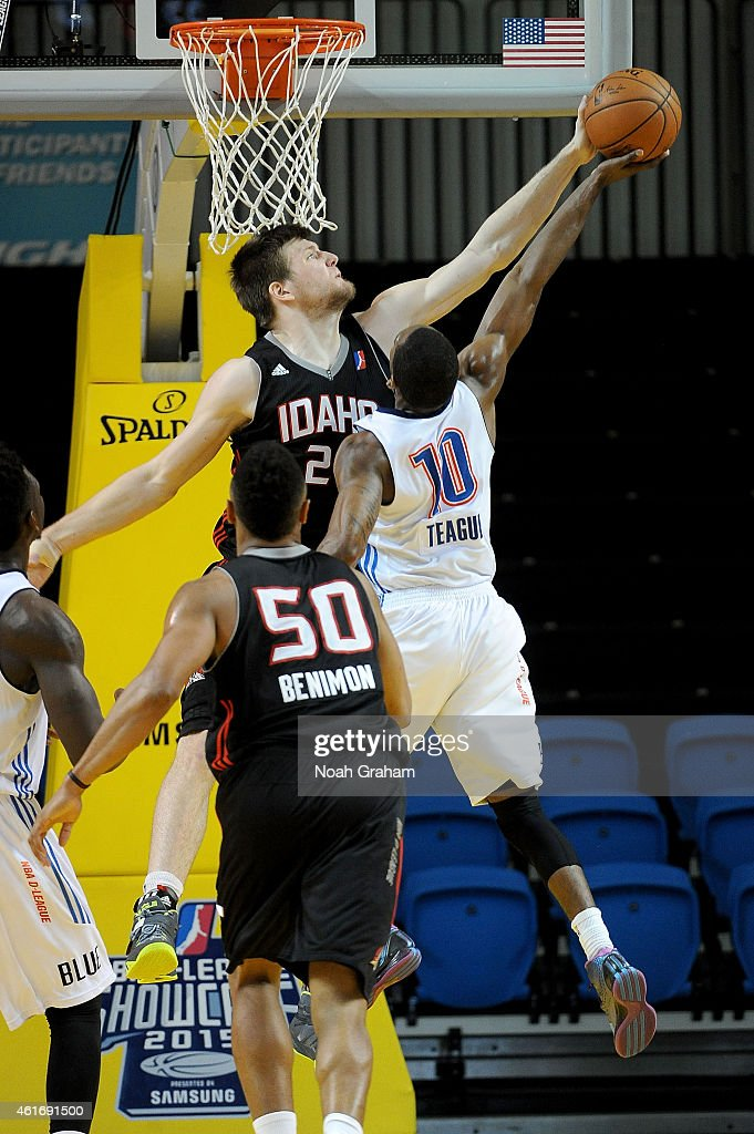 Jack Cooley of the Idaho Stampede blocks Marquis Teague of the Oklahoma City Blue during the 2015 NBA DLeague Showcase presented by Samsung at the...