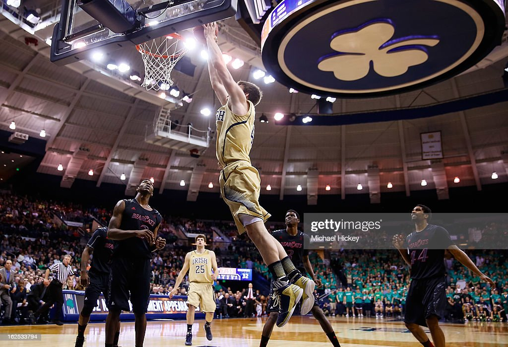 Jack Cooley #45 of the Notre Dame Fighting Irish goes up to dunk against the Cincinnati Bearcats at Purcel Pavilion on February 24, 2013 in South Bend, Indiana. Notre Dame defeated Cincinnati 62-41.