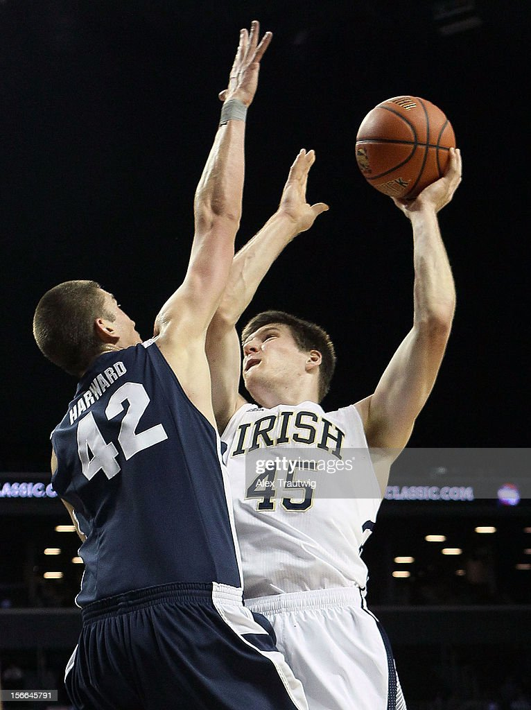 Jack Cooley #45 of the Notre Dame Fighting Irish takes a shot over Ian Harward #42 of the Brigham Young Cougars during the consolation game of the Coaches Vs. Cancer Classic at the Barclays Center on November 17, 2012 in the Brooklyn borough of New York City.
