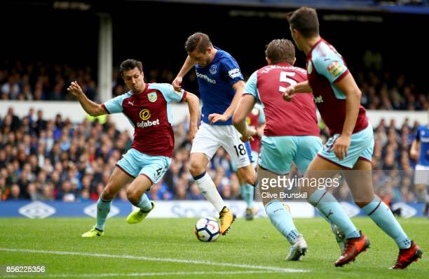 Jack Cork of Burnley attempts to tackle Gylfi Sigurdsson of Everton during the Premier League match between Everton and Burnley at Goodison Park on...