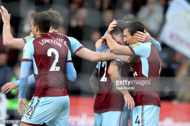 Jack Cork of Burnley celebrates scoring the opening goal with his team mates during the Premier League match between Burnley and Swansea City at Turf...
