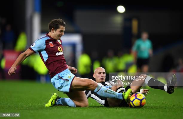 Jack Cork of Burnley is tackled by Jonjo Shelvey of Newcastle United during the Premier League match between Burnley and Newcastle United at Turf...