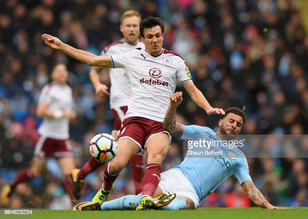 Jack Cork of Burnley is tackled by Kyle Walker of Manchester City during the Premier League match between Manchester City and Burnley at Etihad...