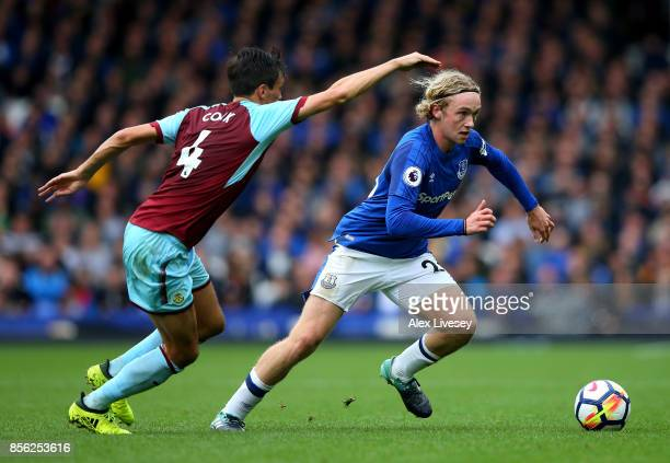 Jack Cork of Burnley puts pressure on Tom Davies of Everton during the Premier League match between Everton and Burnley at Goodison Park on October 1...