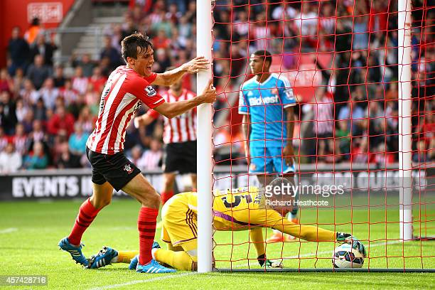 Jack Cork of Southampton beats Vito Mannone of Sunderland to score their third goal during the Barclays Premier League match between Southampton and...