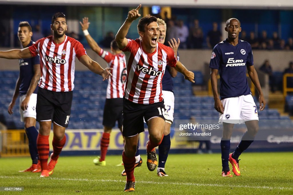 <a gi-track='captionPersonalityLinkClicked' href=/galleries/search?phrase=Jack+Cork&family=editorial&specificpeople=4206991 ng-click='$event.stopPropagation()'>Jack Cork</a> of Southampton celebrates after scoring to make it 1-0 during the Capital One Cup Second Round match between Millwall and Southampton at The Den on August 26, 2014 in London, England.