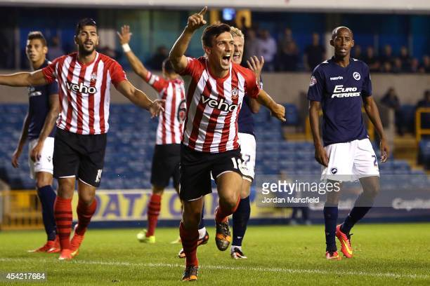 Jack Cork of Southampton celebrates after scoring to make it 10 during the Capital One Cup Second Round match between Millwall and Southampton at The...