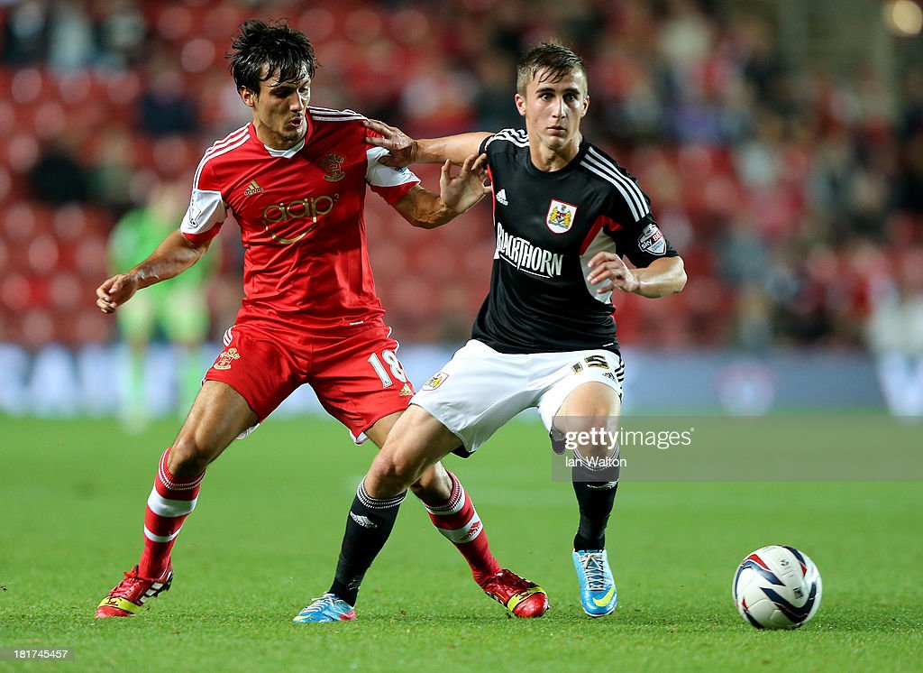 <a gi-track='captionPersonalityLinkClicked' href=/galleries/search?phrase=Jack+Cork&family=editorial&specificpeople=4206991 ng-click='$event.stopPropagation()'>Jack Cork</a> of Southampton competes with Joe Bryan of Bristol City during the Capital One Cup Third Round match between Southampton and Bristol City at St Mary's Stadium on September 24, 2013 in Southampton, England.
