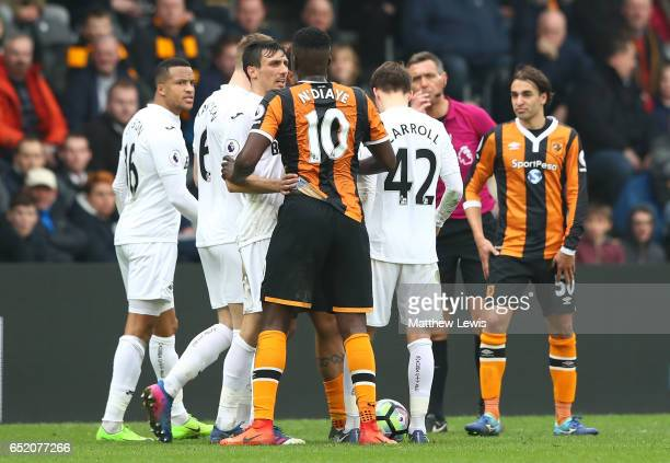 Jack Cork of Swansea City and Alfred N'Diaye of Hull City argue during the Premier League match between Hull City and Swansea City at KCOM Stadium on...