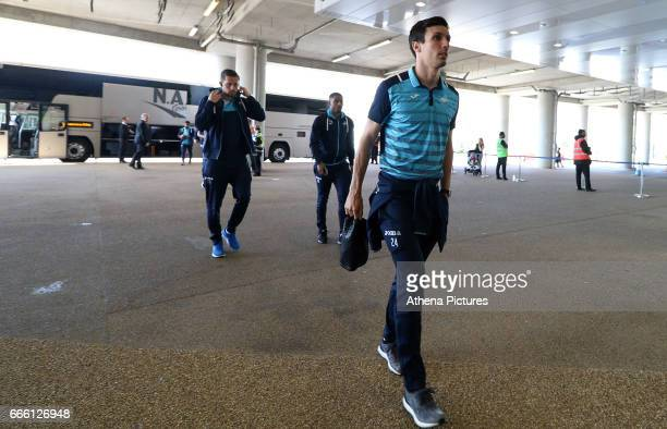 Jack Cork of Swansea City and team mates Gylfi Sigurdsson and Luciano Narsingh arrive prior to kick of the Premier League match between West Ham...