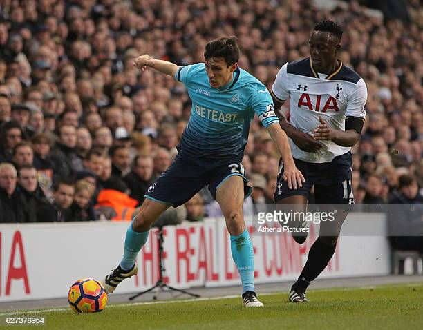 Jack Cork of Swansea City avoids a tackle by Victor Wanyama of Tottenham Hotspur during the Premier League match between Tottenham Hotspur and...