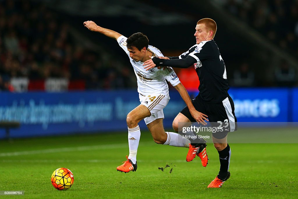 Jack Cork of Swansea City battles for the ball with Ben Watson of Watford during the Barclays Premier League match between Swansea City and Watford at Liberty Stadium on January 18, 2016 in Swansea, Wales.