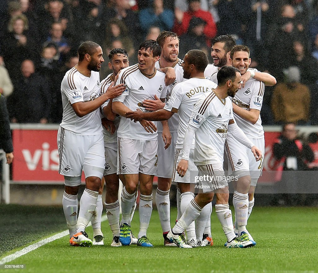 <a gi-track='captionPersonalityLinkClicked' href=/galleries/search?phrase=Jack+Cork&family=editorial&specificpeople=4206991 ng-click='$event.stopPropagation()'>Jack Cork</a> of Swansea City celebrates after scoring the second for Swansea City during a Premier League match between Swansea City and Liverpool at the Liberty Stadium on May 01, 2016 in Swansea, Wales.