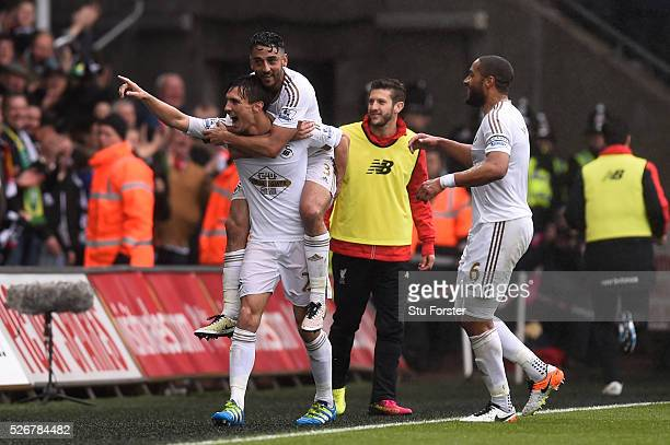 Jack Cork of Swansea City celebrates scoring his team's second goal with Neil Taylor and Ashley Williams during the Barclays Premier League match...