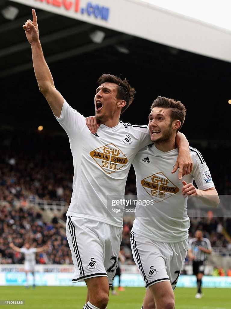 Jack Cork of Swansea City (L) celebrates scoring their third goal with Matt Grimes of Swansea City during the Barclays Premier League match between Newcastle United and Swansea City at St James' Park on April 25, 2015 in Newcastle upon Tyne, England.