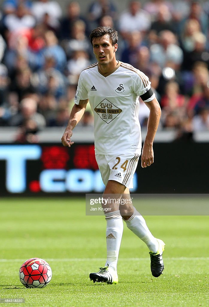 <a gi-track='captionPersonalityLinkClicked' href=/galleries/search?phrase=Jack+Cork&family=editorial&specificpeople=4206991 ng-click='$event.stopPropagation()'>Jack Cork</a> of Swansea City during the Barclays Premier League match between Swansea City and Newcastle United at Liberty Stadium on August 15, 2015 in Swansea, Wales.