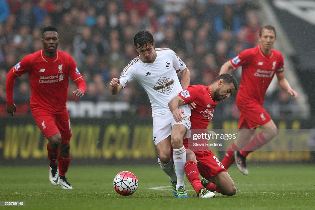 <a gi-track='captionPersonalityLinkClicked' href=/galleries/search?phrase=Jack+Cork&family=editorial&specificpeople=4206991 ng-click='$event.stopPropagation()'>Jack Cork</a> of Swansea City is challenged by <a gi-track='captionPersonalityLinkClicked' href=/galleries/search?phrase=Kevin+Stewart+-+Soccer+Defensive+Midfielder&family=editorial&specificpeople=15535936 ng-click='$event.stopPropagation()'>Kevin Stewart</a> of Liverpool during the Barclays Premier League match between Swansea City and Liverpool at The Liberty Stadium on May 1, 2016 in Swansea, Wales.