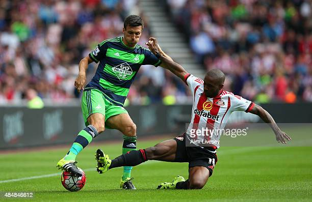 jack Cork of Swansea City is tackled by Jermain Defoe of Sunderland during the Barclays Premier League match between Sunderland and Swansea City at...