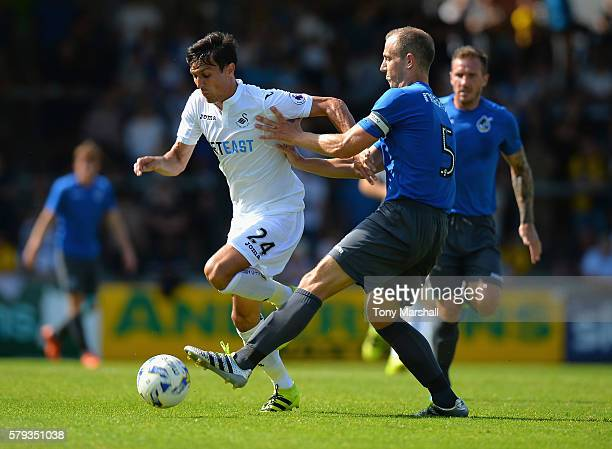 Jack Cork of Swansea City is tackled by Mark McChrystal of Bristol Rovers during the PreSeason Friendly match between Bristol Rovers and Swansea City...