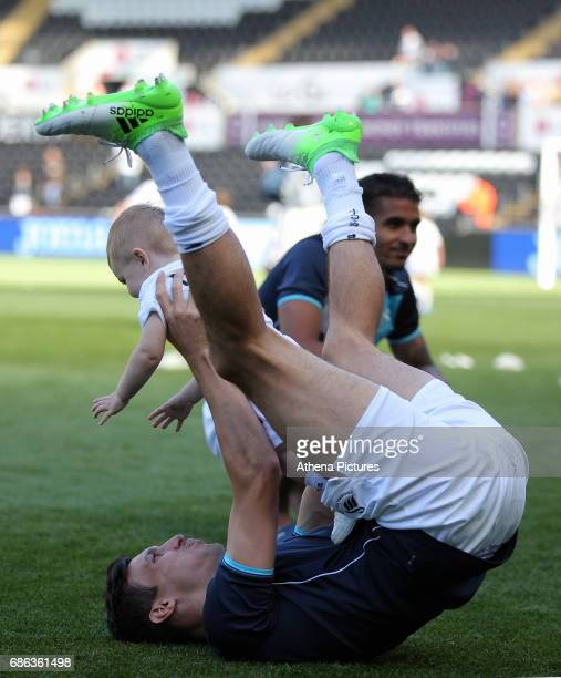 Jack Cork of Swansea City plays with his young child after the Premier League match between Swansea City and West Bromwich Albion at The Liberty...