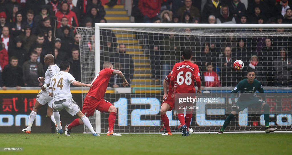 <a gi-track='captionPersonalityLinkClicked' href=/galleries/search?phrase=Jack+Cork&family=editorial&specificpeople=4206991 ng-click='$event.stopPropagation()'>Jack Cork</a> of Swansea City scores his team's second goal during the Barclays Premier League match between Swansea City and Liverpool at The Liberty Stadium on May 1, 2016 in Swansea, Wales.