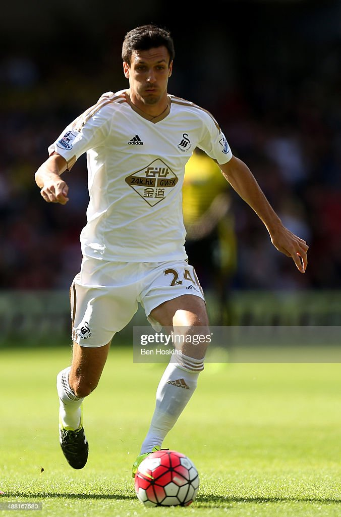 <a gi-track='captionPersonalityLinkClicked' href=/galleries/search?phrase=Jack+Cork&family=editorial&specificpeople=4206991 ng-click='$event.stopPropagation()'>Jack Cork</a> of Swansea in action during the Barclays Premier League match between Watford and Swansea City at Vicarage Road on September 12, 2015 in Watford, United Kingdom.